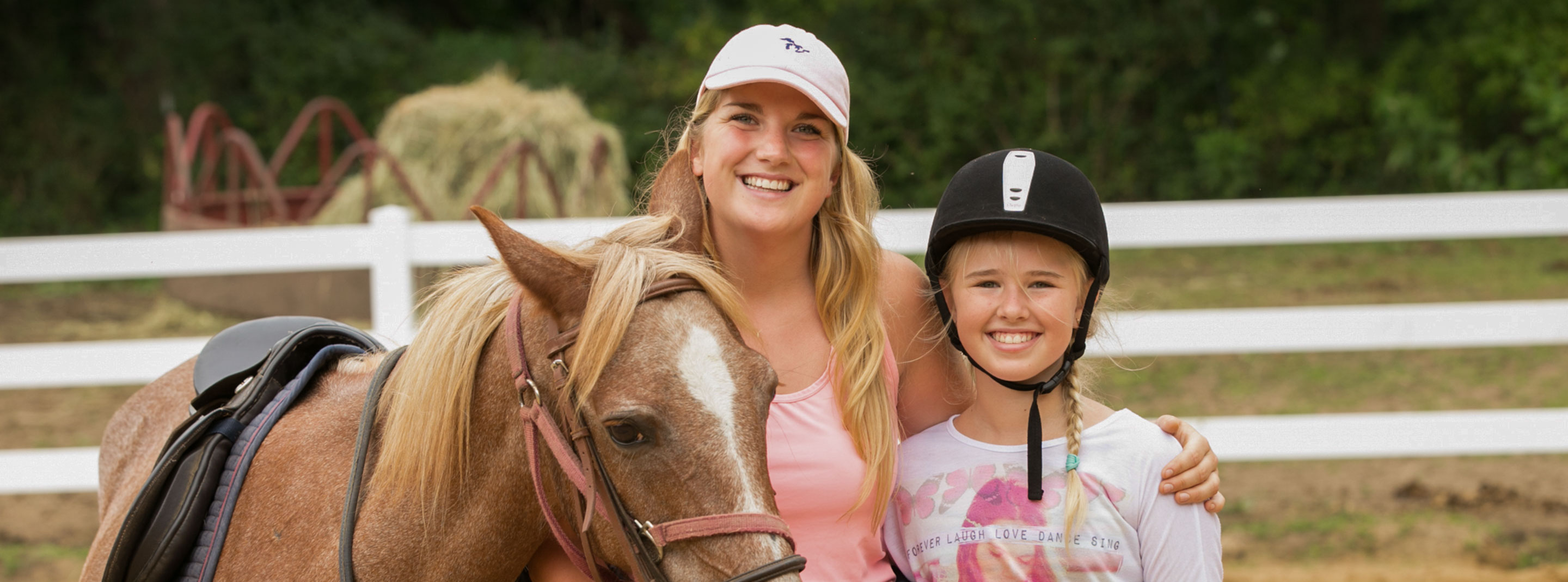 Staff and camper at horseback riding